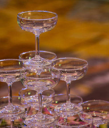 Stack of champagne glasses in wedding party photo