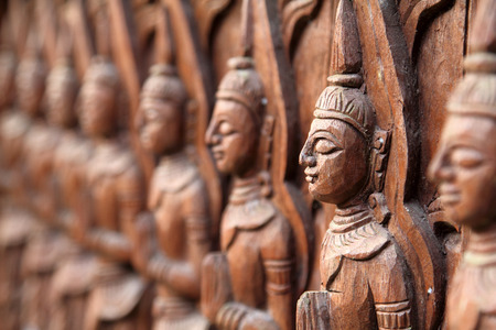 wood craft: Closeup buddha wall of wood craft in temple, Thailand