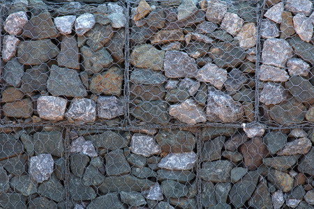 gabion mesh: Stones in iron net to make wall