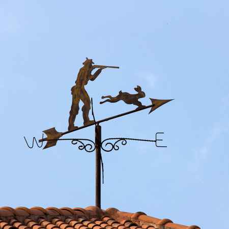 windward: Weather vane with blue sky