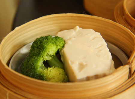 person appetizer: Traditional Chinese cuisine dim sum broccoli and tofu Stock Photo