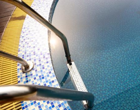 pool bars: Grab bars ladder in blue swimming pool