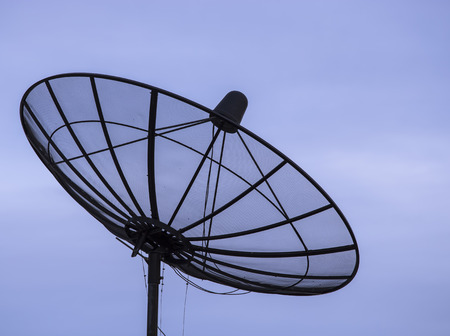 Silhouette satellite dish on blue sky background Stock Photo