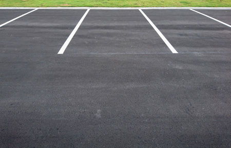 Empty parking with white marking line on floor Фото со стока