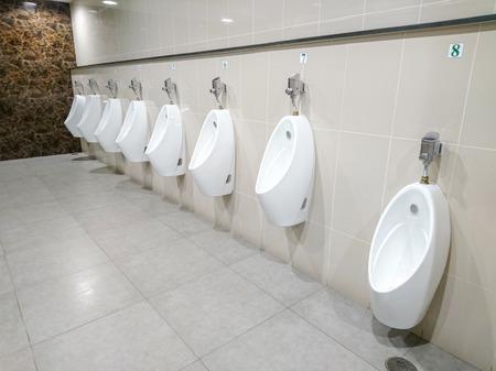 Empty public men toilet in shopping mall