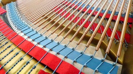 Strings inside of grand piano