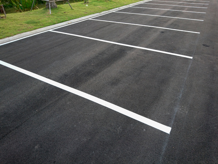 Empty parking with white marking line on floor Imagens
