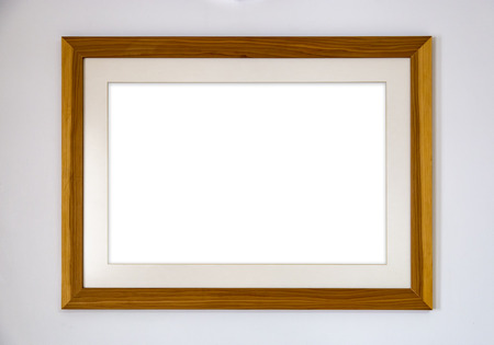 Blank photo wood frame on the wall 写真素材