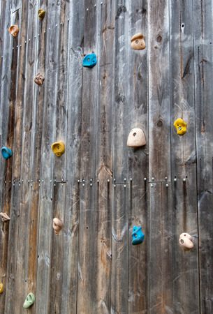 Artificial rock climbing wall on wood board