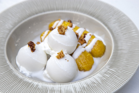 Coconut ice cream with banana in syrup, Thai dessert