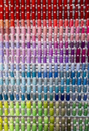 Colorful thread spool decoration of wall background
