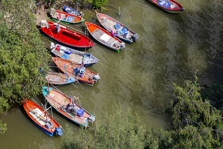 Small fishing boats parked at estuary before going out to fish 写真素材