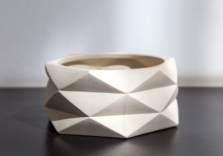 Empty white clay flower pot on  the table