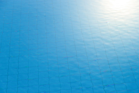 Blue swimming pool reflecting the sun rippled 写真素材