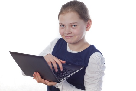 a smiling girl with a netbook on the white background Stock Photo