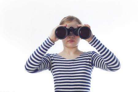 return trip: girl sailor in the shirt looks in binoculars