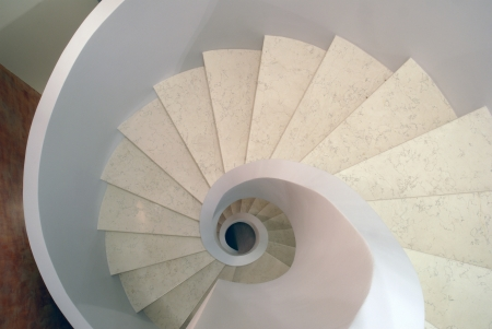 a spiral staircase from the white marble  top view