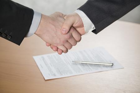 the handshake,the two men shake hands