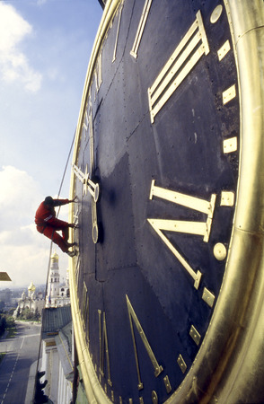 climber on  astronomical clock of Spasskaya tower  Moscow Kremlin