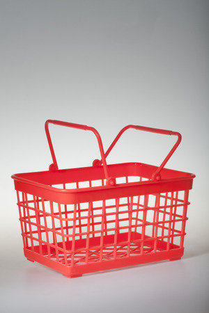 the red basket on white background plastic
