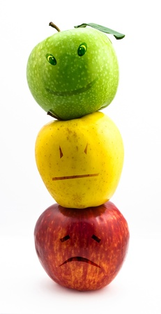 buena salud: Manzana emociones en el fondo blanco Foto de archivo
