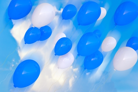 3d party balloons birthday decoration multicolor  on the sky background  Stock Photo