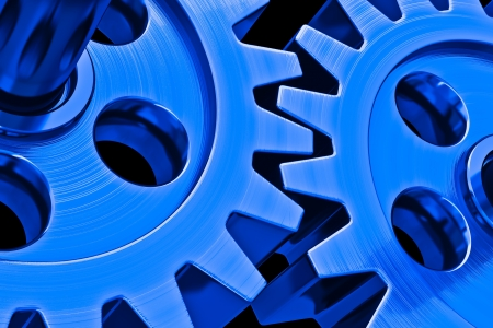 blue gears on black background Stock Photo