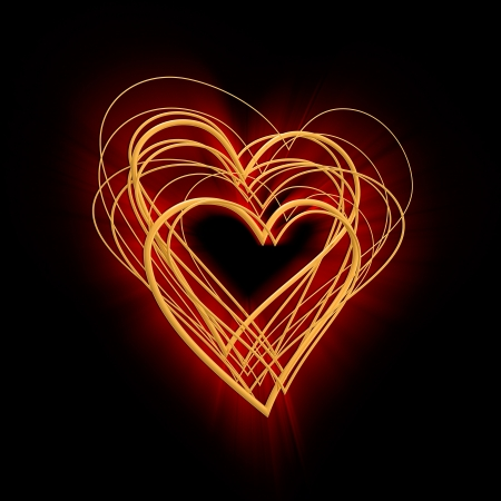 abstract glowing heart of gold on a black background photo