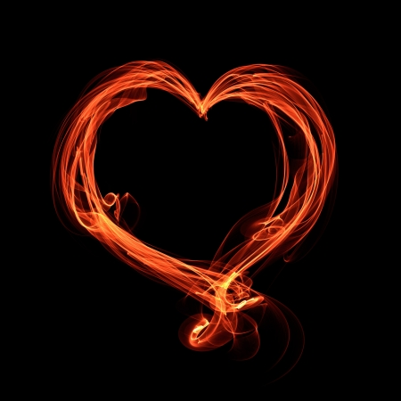 abstract glowing fiery heart on a black background Stock Photo