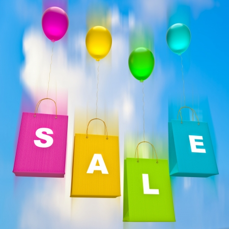 colorful bags with balloons  sale  on sky background
