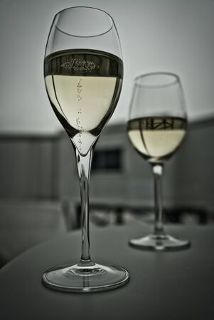 Two glasses of Prosecco champagne, photographed from the side, at the airport business lounge before departure