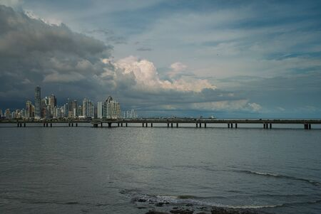 The historic old town of Panama, the modern skyline with bridge and skyscrapers photographed over the sea Standard-Bild - 140219378