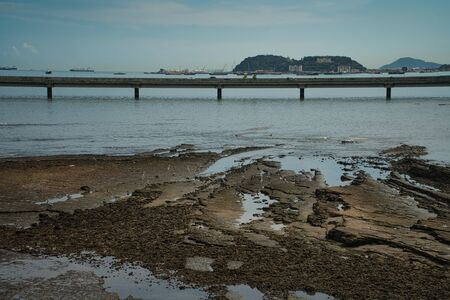 Bridge around the old town of Panama with rocks and birds at low tide