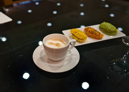 Finger food, sandwiches and a cup of cappuccino in a sophisticated atmosphere and business lounge
