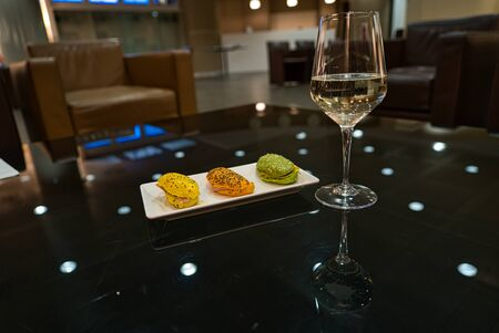 Finger food, sandwiches and a glass of champagne in an upscale atmosphere and business lounge