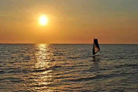 Windsurf board at sunset off the coast of Phu Quoc Island, Vietnam Stock Photo