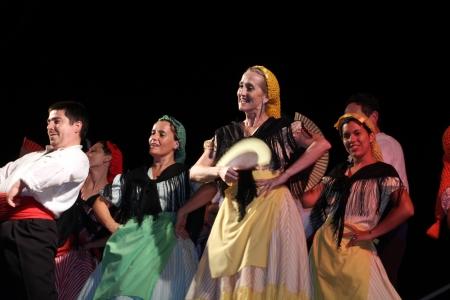 show folk: Lignano, Italy - september 8, 2012.Esbart Dansaire del Vall?de Barcelona folk dancers during the show danzando tra i popoli Editorial