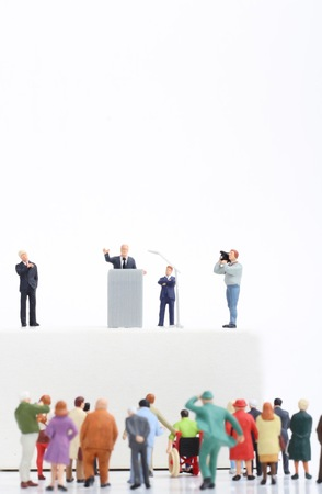 rally: miniature figurines of a politician speaking to the people during an election rally