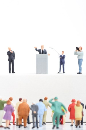 politician: miniature figurines of a politician speaking to the people during an election rally
