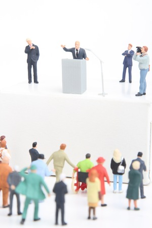 senate elections: miniature figurines of a politician speaking to the people during an election rally