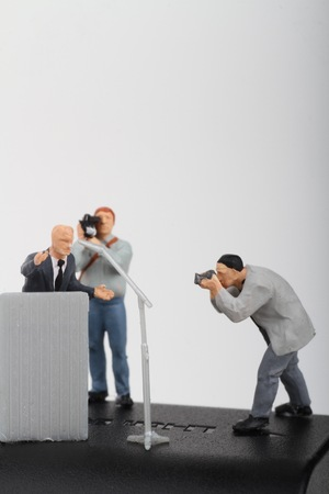 campaign promises: miniature figurines of a politician speaking to the people during an election rally