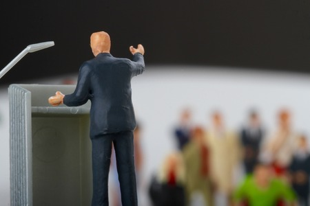 orator: miniature figurines of a politician speaking to the people during an election rally