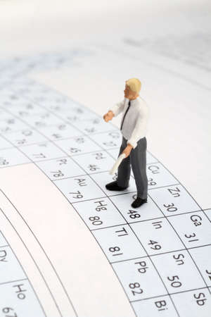 miniature chemistry professor on periodic table Archivio Fotografico