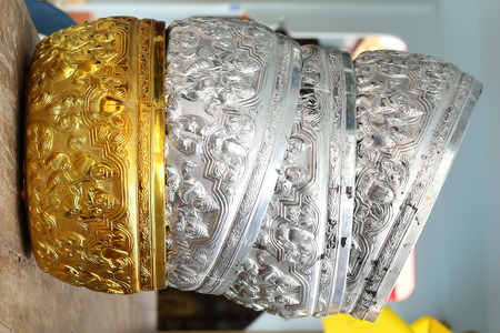 bronze bowl: Stack of Golden and Silver Bowls
