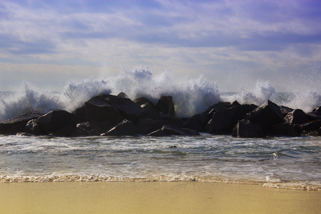 storm tide: Stormy ocean waves, beautiful seascape, big powerful tide in action, storm weather in a deep blue sea, forces of nature, natural disaster.