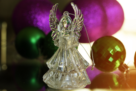 Crystal Angel On The Background Of Christmas Balls. New Year Decoration. Christmas  Ornaments,