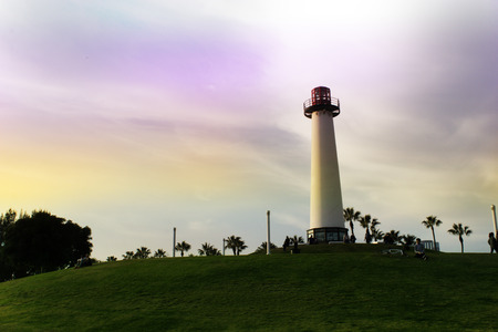 navigational light: Lighthouse at Pine Avenue Pier. embankment on sunset, California, USA. Long beach, Los-Angeles