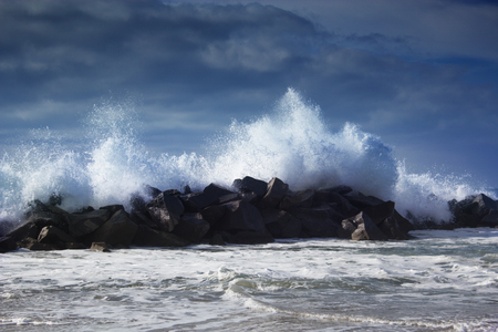 photo edges: Stormy ocean waves beautiful seascape big powerful tide in action storm weather in a deep blue sea forces of nature natural disaster.ocean wave in the Pacific ocean Stock Photo