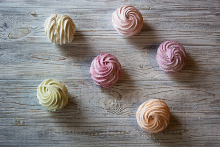pastila: Homemade marshmallows on a light wooden background. Delicious homemade sweetmarshmallow