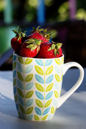 Fresh red strawberries in a cup